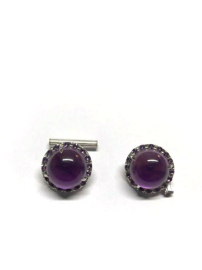 Beautifully handcrafted in Italy,   in Margherita Burgener workshop, the unique cufflinks features an elegant round cabochon cut Amethyst, layered by Mother of Pearl, surrounded by a line of faceted round amethysts.  Connected by two gold ovals link
