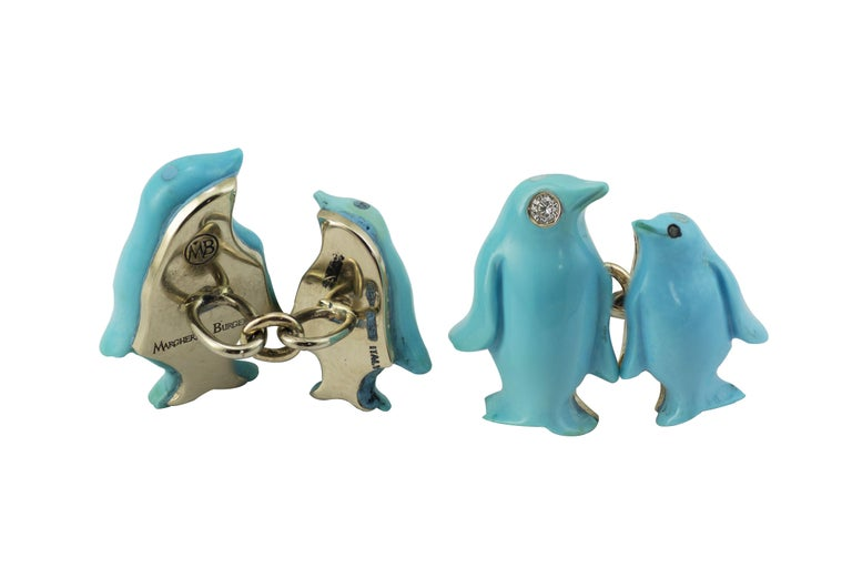 Designed as penguins in carved natural turquoise, the cufflinks feature a bigger penguin as front part and a smaller one as back.  The turquoise  is layered in white gold. The bigger penguin  has the eye in diamond, the smaller one has a little onyx