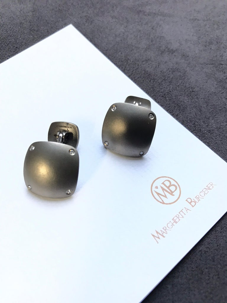 Handcrafted in Margherita Burgener workshop in Italy,  modern yet evergreen pair of cufflinks. Titanium made they are highlighted by 8 diamonds for total ct 0,08 18KT white gold total grams 1.30 Signed Margherita Burgener   On request we can