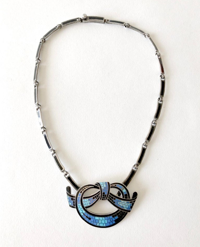 Gorgeous mosaic enameled sterling silver necklace which can convert to a brooch created by Mexican modernist jeweler, Margot de Taxco.  Necklace chain measures 16