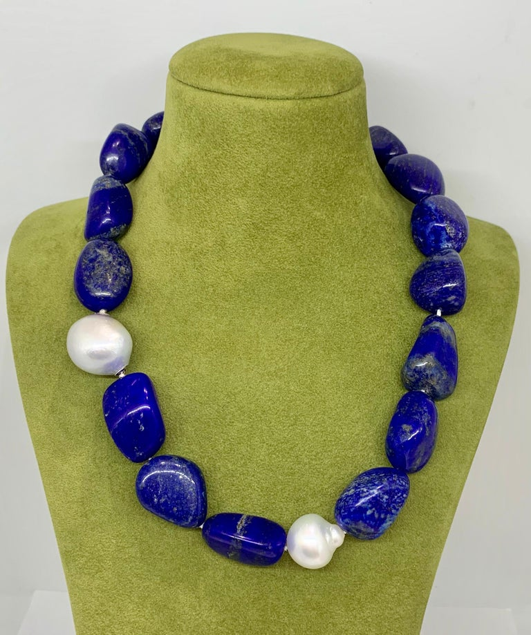 Margot McKinney 18 Karat White Gold South Sea Pearl and Lapis Necklet featuring two Silver White Baroque 17.5mm - 21mm Australian South Sea Pearls and seventeen 20mm Lapis Lazuli tumbled Pebbles, Length 52cm.  Clasp is an Interchangeable 20mm - 21mm