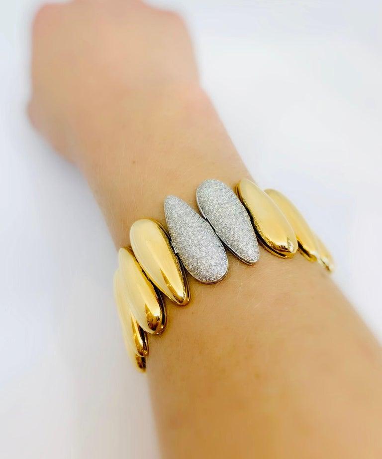 Margot McKinney 18 Karat White and Rose Gold Bracelet with tear drop gold and diamond links set with 4.11 carat Diamonds.   Length:  19.5cm