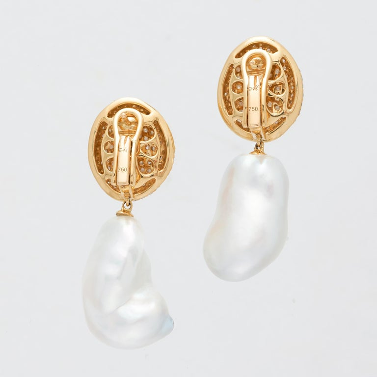 Margot McKinney 18 karat Yellow Gold South Sea Pearl & White Diamond Drop Earrings featuring a pair of baroque South Sea pearls 14-16mm and an average 2.7 carat of diamonds.