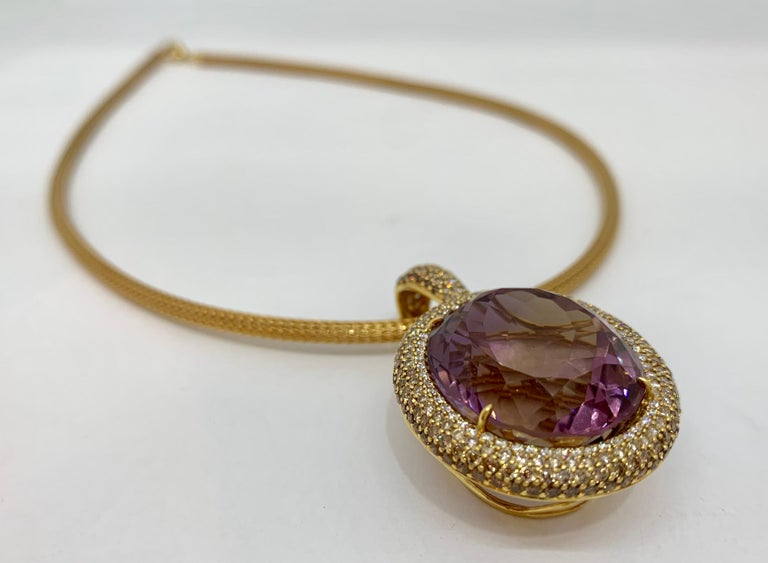 Margot McKinney 18 Karat Yellow Gold 3 mm mesh link Necklace, 45 cms length, features a parrot clasp with an 18 karat Yellow Gold Ametrine pendant featuring a 58.92 carat oval cut Ametrine surrounded by 55 White Diamonds 0.48 carat and 223 Cognac