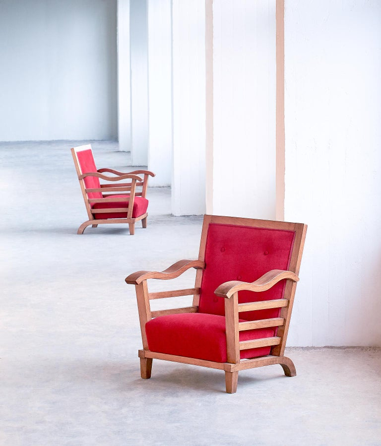 These striking armchairs were designed by Marguerite Dubuisson in 1947. Dubuisson was a French artist mostly working in textile design. However, in the late 1940s she designed a few interiors including some rare furniture pieces, mostly executed in