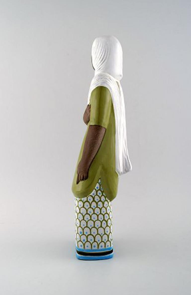 Mari Simmulson figure, ceramics, Upsala-Ekeby. Indonesian woman, Sweden, mid-20 century. Measures: Height 37 cm. In perfect condition. Marked.