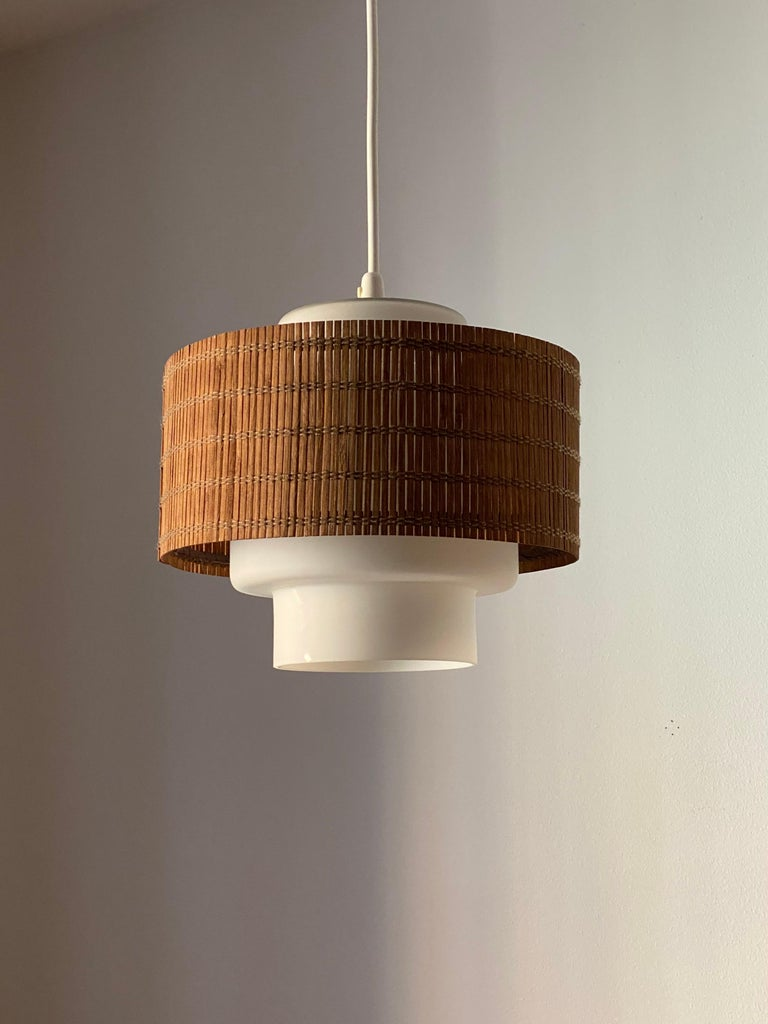 A ceiling light / pendant light. Designed by Maria Lindeman, produced by Idman, Finland, 1950s.  Stated dimensions excluding ceiling cup and cord.  Other designers of the period include Paavo Tynell, Lisa Johansson-Pape, Alvar Aalto, Ilmari