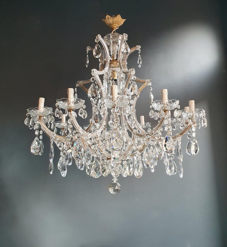 The frame is fully dressed all-over with glass. Cut crystal drops of different dimensions and shapes are hanging all-over the octagonal button chains, all around the chandelier.  Measures: Total height 150 cm, height without chain 95 cm, diameter