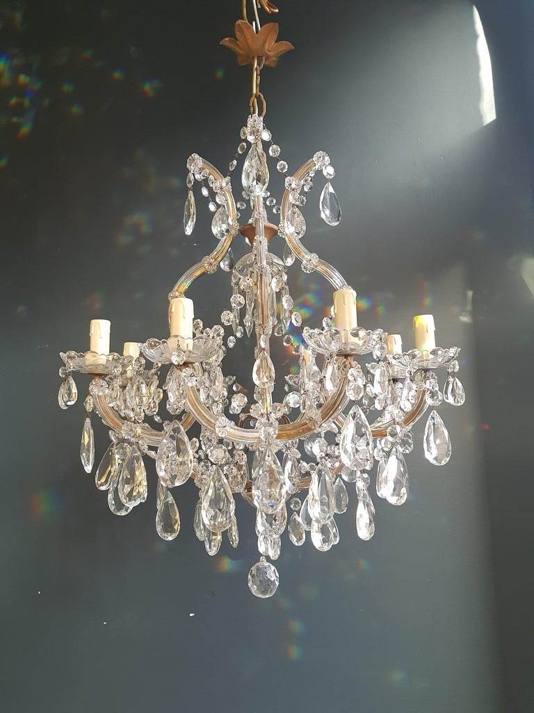 The frame is fully dressed all-over with glass. Cut crystal drops of different dimensions and shapes are hanging all-over the octagonal button chains, all around the chandelier.  Measures: Total height 150 cm, height without chain 70 cm, diameter