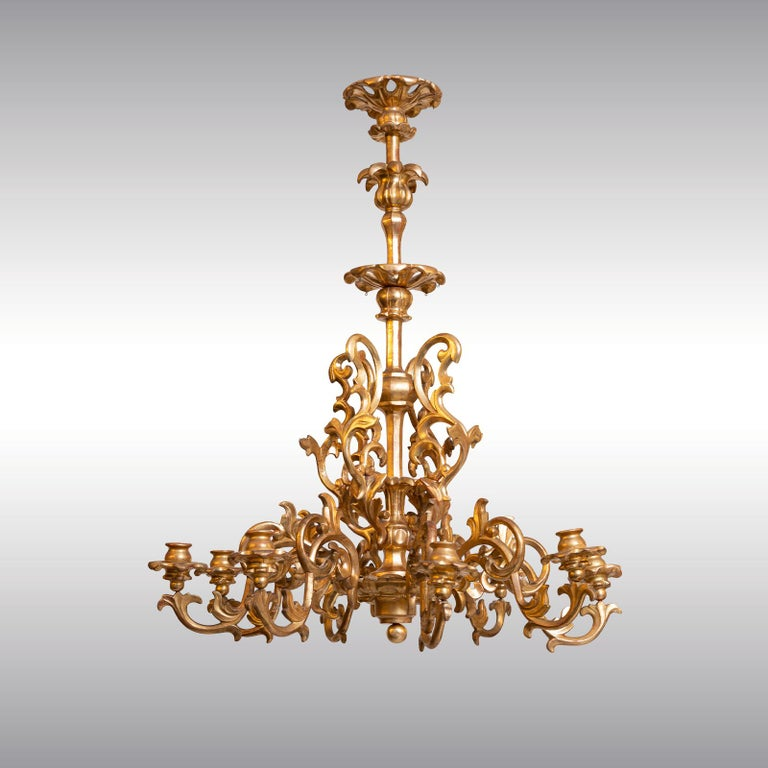 Unelectrified carved chandelier, leaf-gilded on poliment-ground, 8-flames. Newly restored. This is a original item of the time of Maria Theresia and Mozart. Can be electrified on demand.