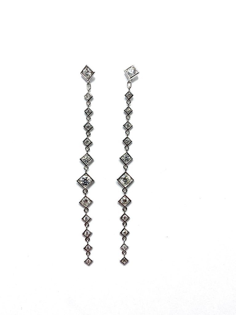 Handcrafted in Italy by Mariani Gioielli this stunning pair of Diamond drop earrings will light up the night!  The 24 round brilliant Diamonds have a total weight of 1.64 carats set in 18 karat white gold.  They are E/F color, VVS2 clarity.  The