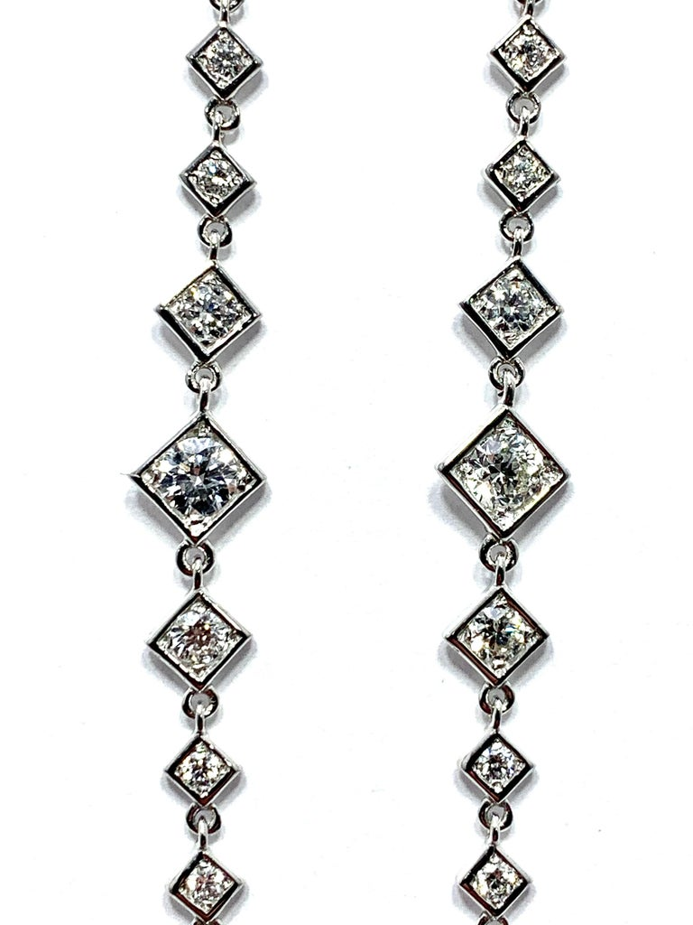 Modern Mariani 1.64 Carat Round Brilliant Diamond and 18 Karat Gold Dangle Earrings For Sale