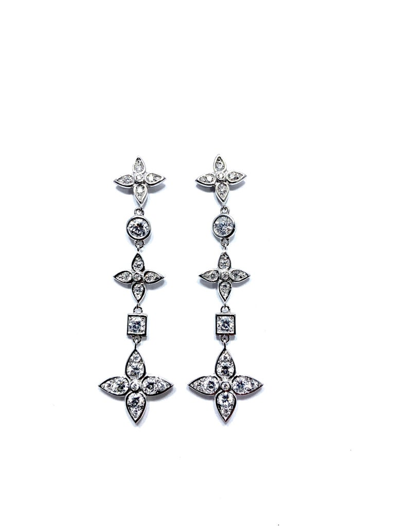 Handcrafted in Italy by Mariani Gioielli this stunning pair of Diamond drop earrings will light up the night!  The 42 round brilliant Diamonds have a total weight of 1.92 carats set in 18 karat white gold.  They are E/F color, VVS2 clarity.  The