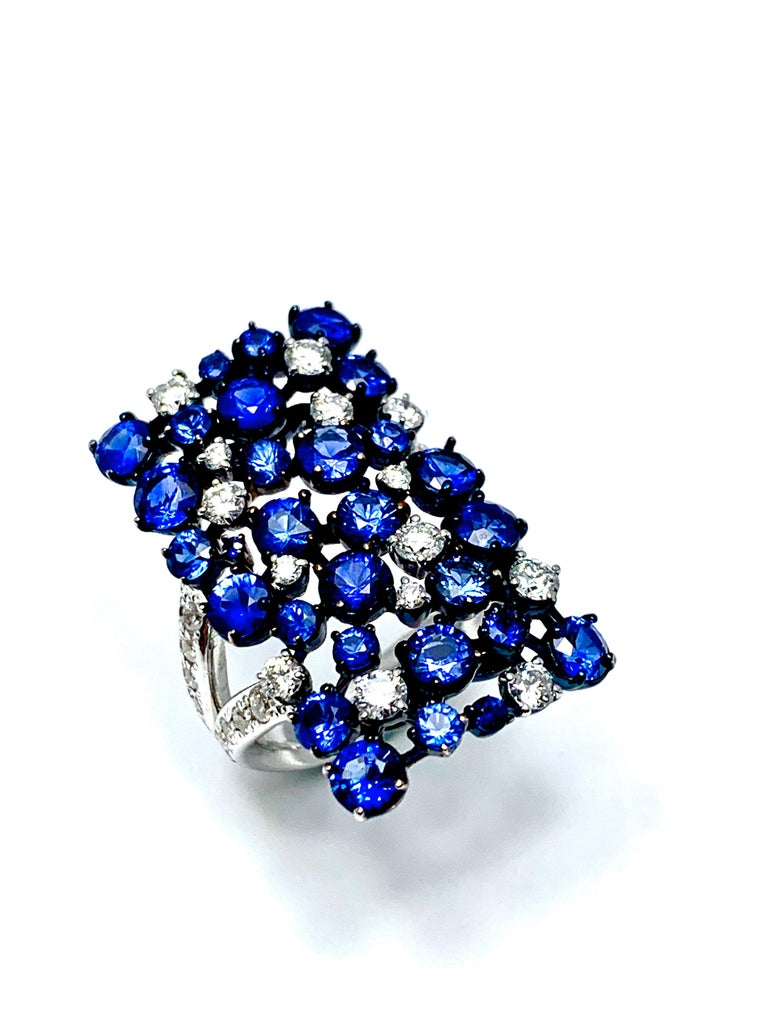 Handcrafted in Italy by Mariani Gioielli this stunning 18k white and blue gold ring will make a statement.  Adorned with 5.15 carats of round faceted sapphires, and 1.50 carats of round brilliant diamonds, this ring is a show stopper.  The diamonds