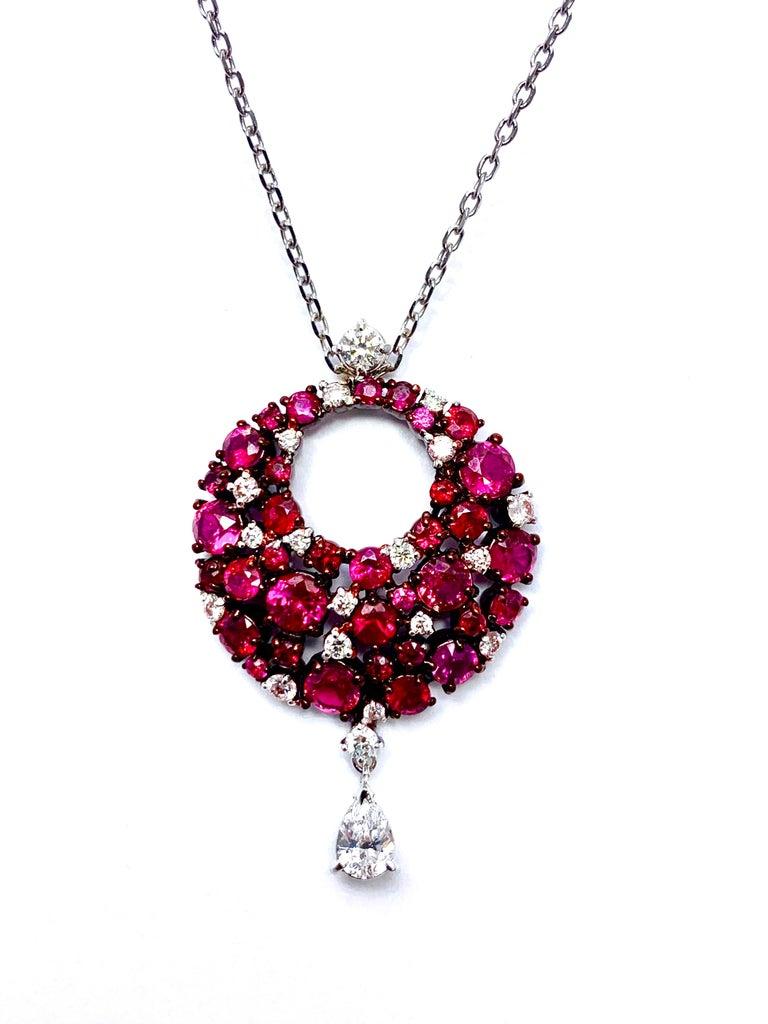 Exquisite Ruby and Diamond Pendant, part of the Eclipse Collection of Mariani. Features multiple shapes and hues of Rubies and Diamonds arranged in this circle and finished with a pear shape diamond drop at the base.  There is a total of 2.25 carats
