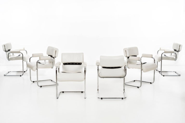 Maraini foe Pace dining chairs set of 8, tubular chrome frame with upholstered leather seat and back with strips of detailed strips of leather for cushion support and padded arms.