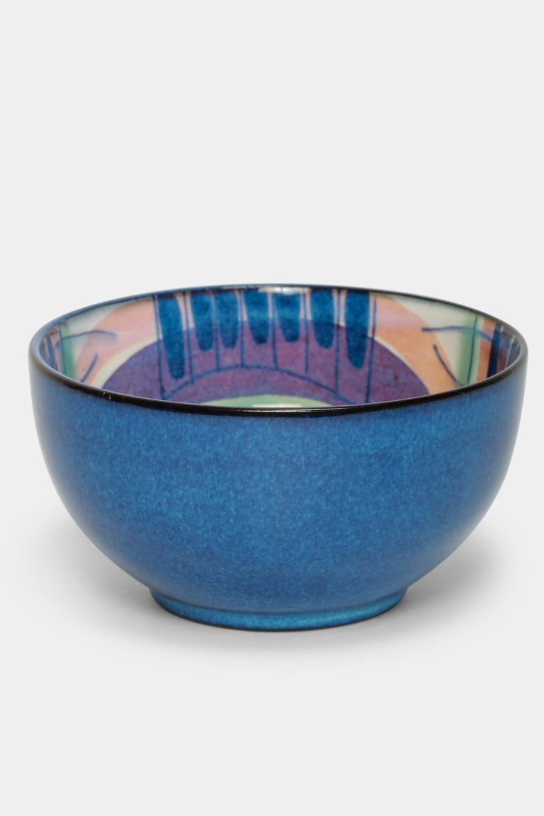 Marianne Johnson bowl made by Royal Copenhagen in the 1960s in Denmark. Painted ceramic bowl in with vibrant colors, bright details and flowing transitions. Marked at the bottom with the designer's initials and numbered 137/2196.