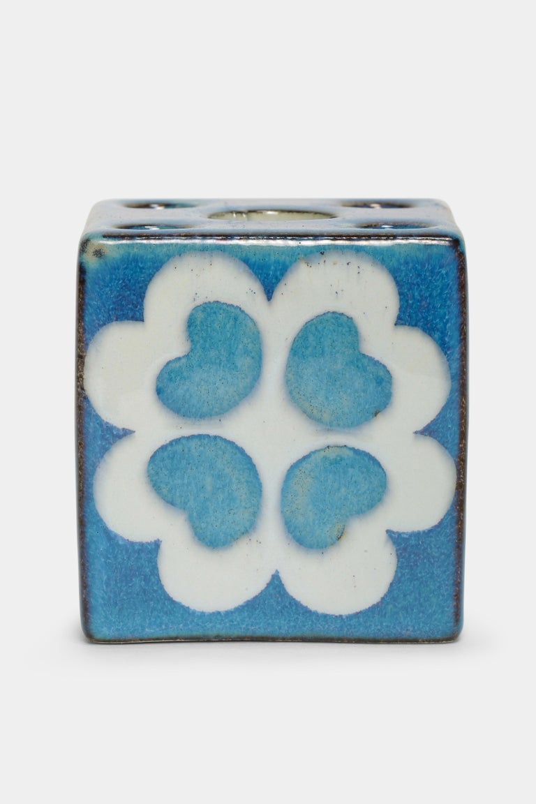Marianne Johnson candleholder made by Royal Copenhagen in the 1960s in Denmark. Cube painted with a bright blue color. Marked an the bottom with the designer's initials and numbered 432/3500.
