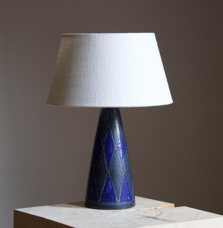 A table lamp designed by Marianne Starck produced by Michael Andersen Keramik. Signed and stamped  Purchase excludes lampshade. Stated measurements excluding lampshade. Height includes socket.  Other ceramicists of the period include Axel Salto,