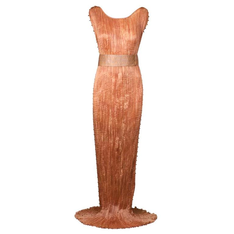 Mariano Fortuny apricot Delphos gown, early 20th century, offered by Vintage Luxury