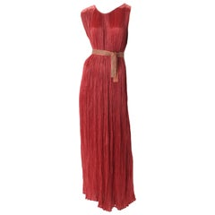"Mariano Fortuny Pleated Coral Silk ""Delphos"" Gown, c.1920s."