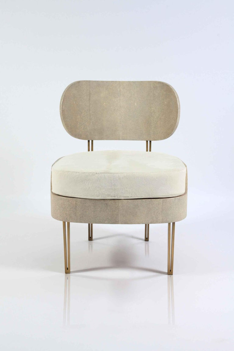 The Marie Antoinette chair by R&Y Augousti is a sophisticated piece that provides comfort, whilst retaining its elegant and luxurious aesthetic. This piece is inlaid in cream shagreen, finished with a cream horsehair cushion. The ends of the feet