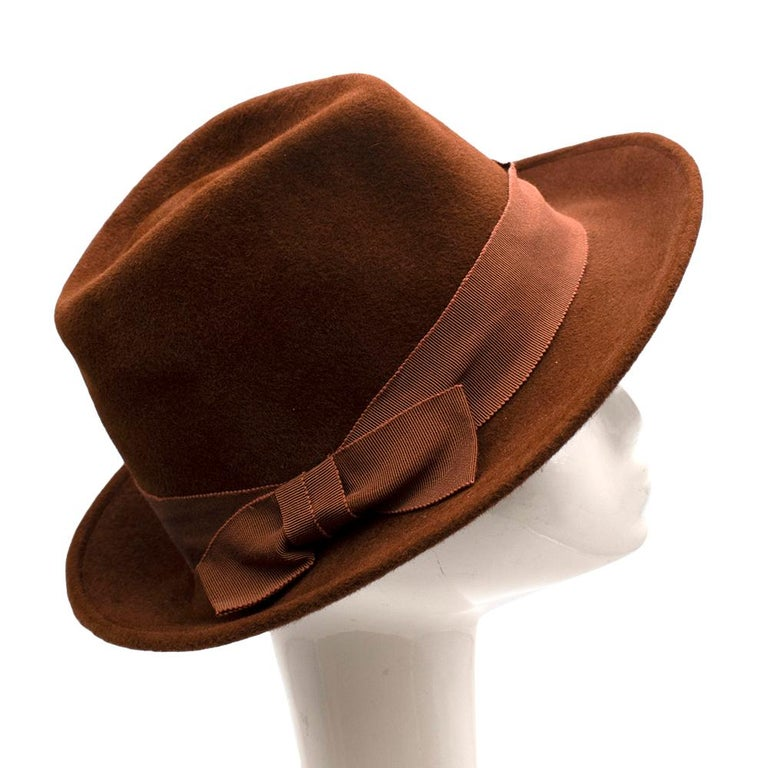 Marie Mercie Brown Felt Hat   -Rich warm brown color   -Luxurious soft texture  -Cotton band  -Bow detail on the side  Materials:  Main: 100% high quality rabbit felt  Made in France  Circumference- 58 cm