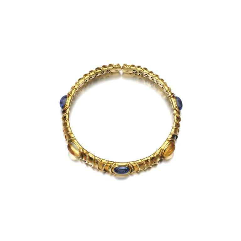 Marina B 18kt yellow gold choker, enriched with alternated blue and yellow cabochon sapphires. Made in Italy, circa 1984.