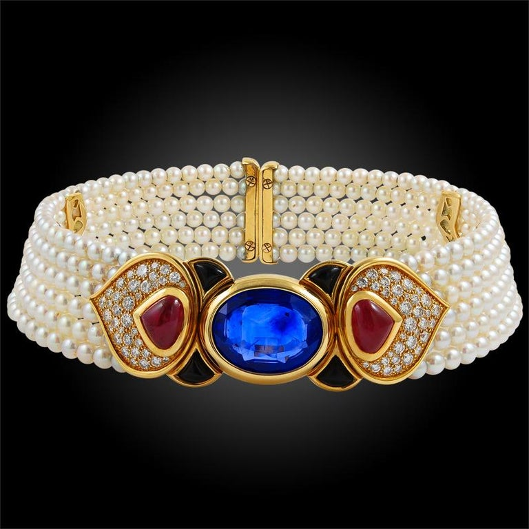 A magnificent set by Marina B that dates back to the 1980s, comprising a pearl choker necklace and matching earrings. The expandable necklace is set at the center with a large Ceylon sapphire weighing approximately 26.25 carats. The exceptional