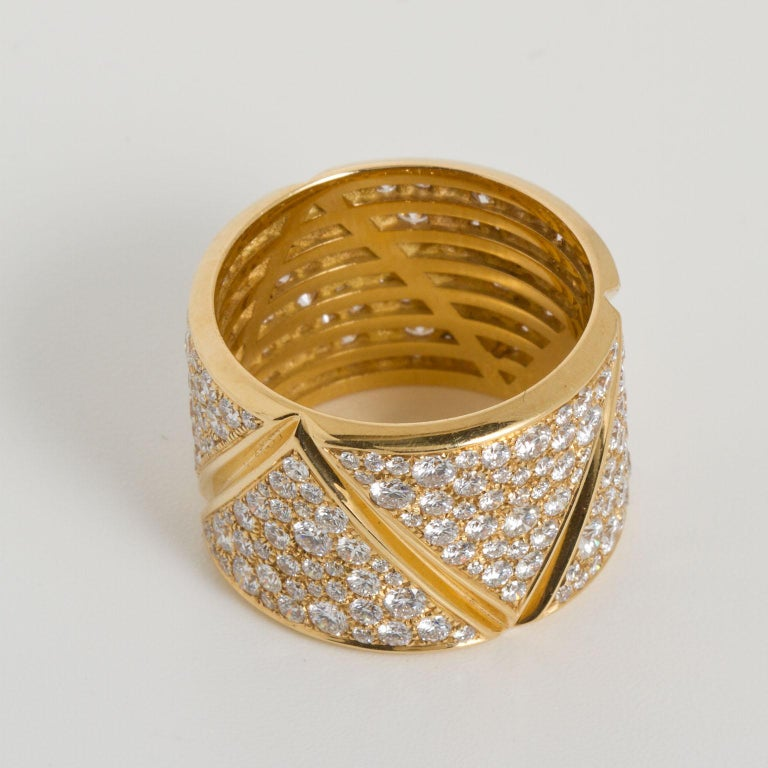 A wide band geometric motif ring by Marina B. Set with 3.46 ctw of round brilliant diamonds. Ring size 7.50.  No. TMWJ-190506-5