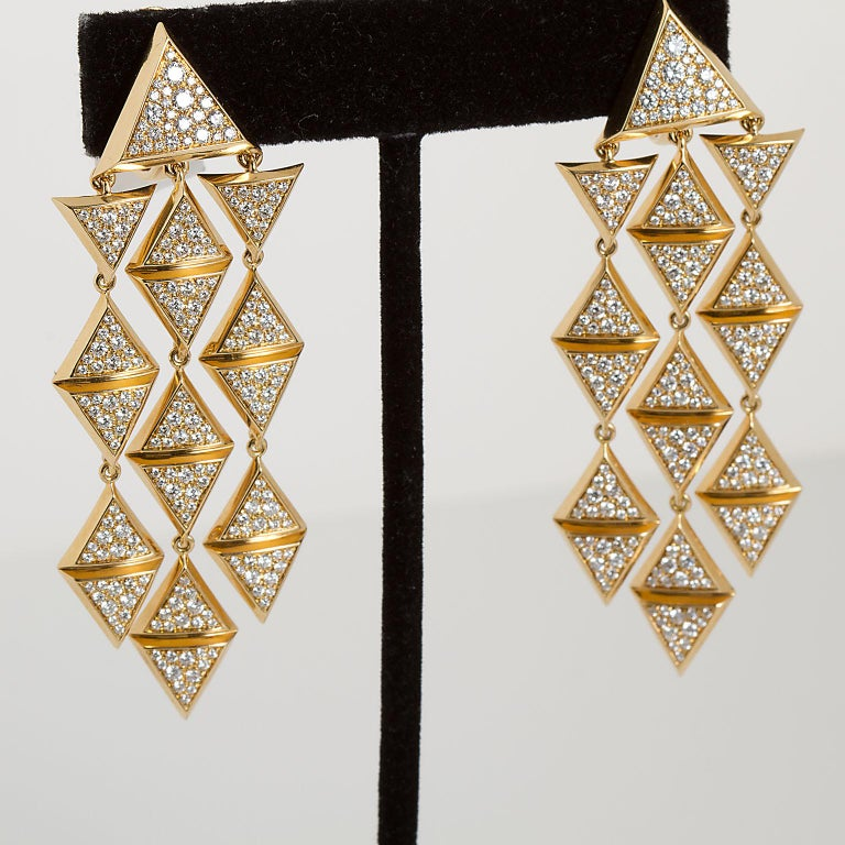 A pair of dangle style earrings in a geometric cascading triangle design by Marina B. Set with 3.45 ctw of round diamonds these hang down 2.75 inches.  No. TMWJ-190506-6