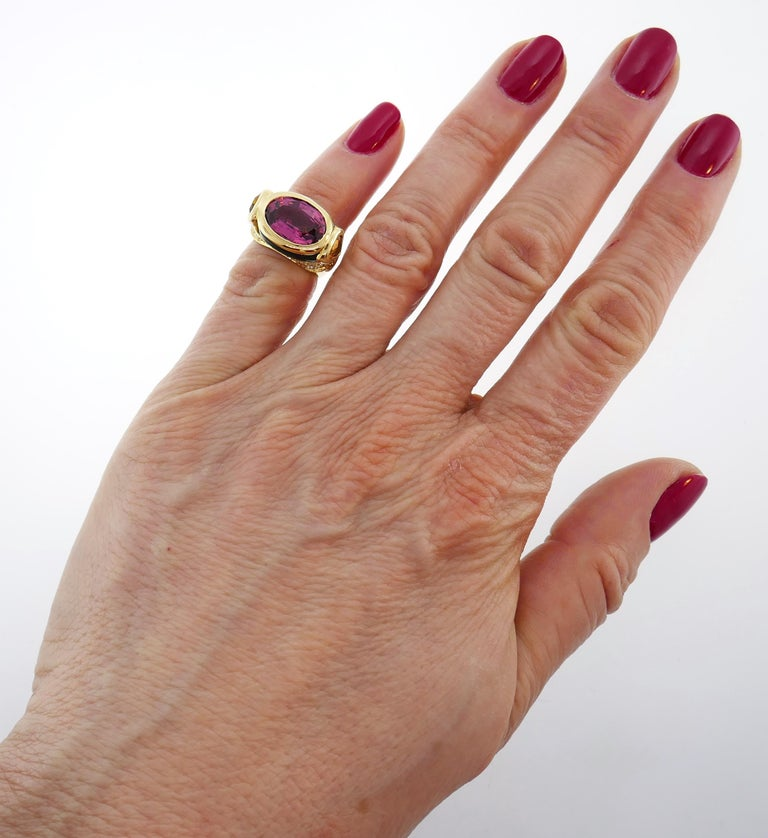 Colorful and chic cocktail ring created by Marina B in 1980s. It definitely makes a statement! Elegant and wearable, the ring is a great addition to your jewelry collection. Features a faceted oval-shape tourmaline set in 18 karat yellow gold