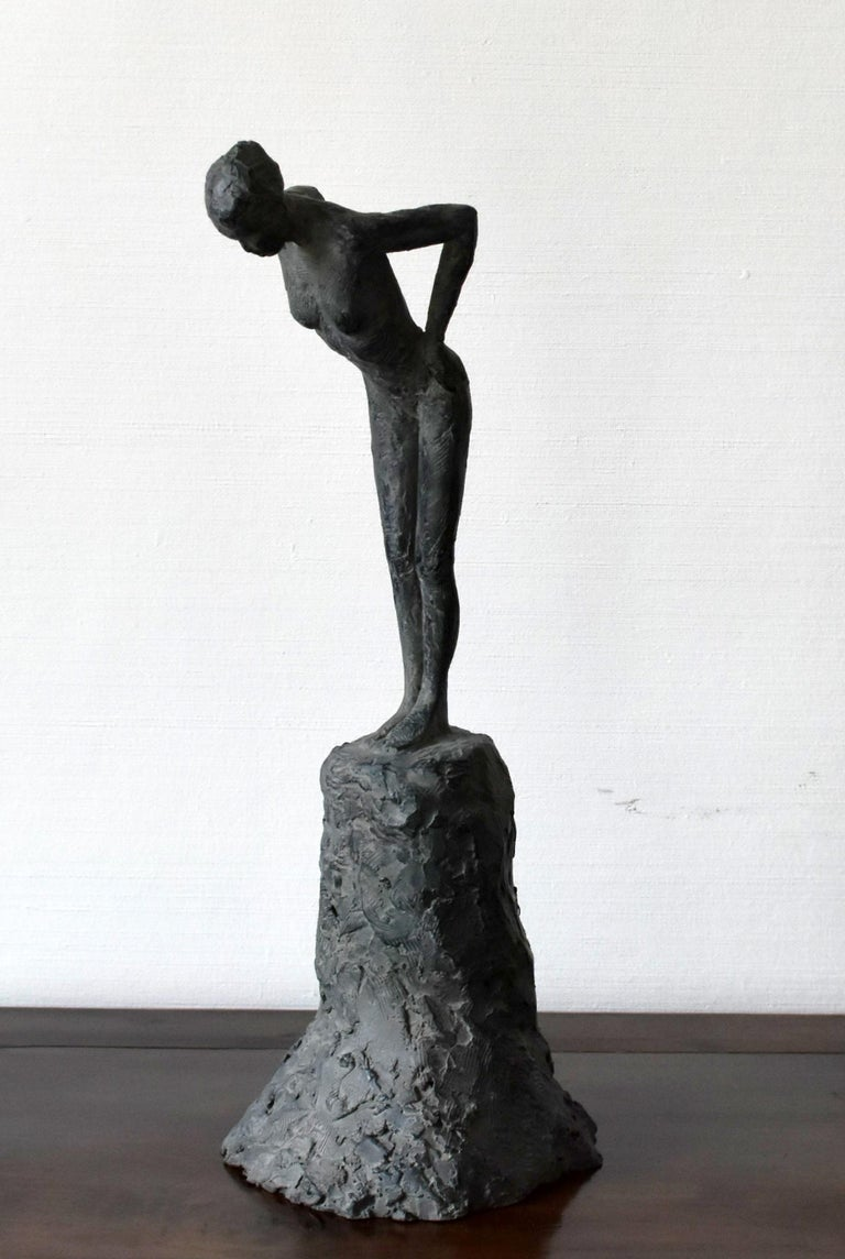 """Attitude III is a bronze sculpture by French contemporary sculptor Marine de Soos depicting a nude female figure leaned forward. This statue belongs to the """"Figures"""" series. It is produced in limited edition of 8 copies and IV artist's proofs. 41.5"""
