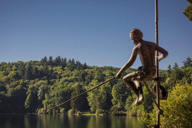 Fisherman on Stilt is a large-scale sculpture by French contemporary artist Marine de Soos.  Bronze, 253 cm × 126 cm × 175 cm. Each of Marine de Soos' sculptures has its story, being a memory of a real moment or an imaginary scene, reconstituted