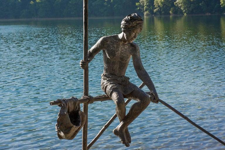 Marine de Soos Figurative Sculpture - Fisherman on Stilt, Large Outdoor Bronze Sculpture