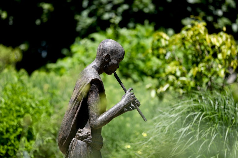 Flute Player is a large-scale bronze sculpture by French contemporary artist Marine de Soos.   170 cm × 122 cm × 35 cm. Limited edition of 8 copies and IV artist's proofs. Each of Marine de Soos' sculptures has its story, being a memory of a real