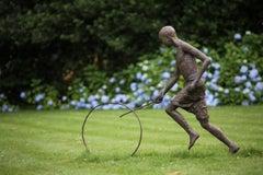 Hoop Rolling Boy by Marine de Soos - Large Outdoor Bronze Sculpture