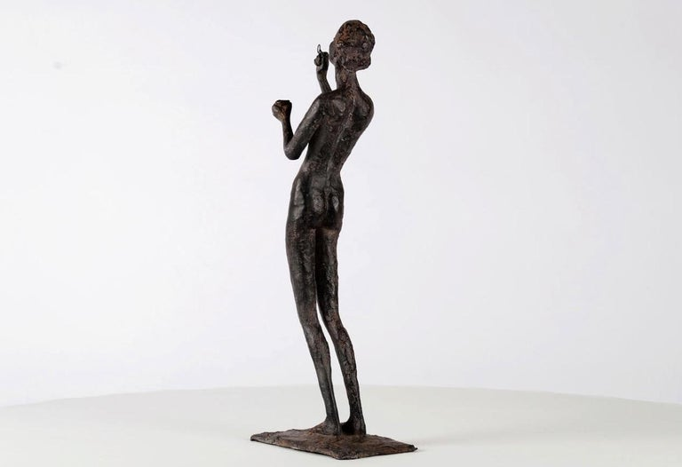 Wandering Light is a bronze sculpture by French contemporary artist Marine de Soos which represents a naked young woman blowing soap bubbles. Each of Marine de Soos' sculptures has its story, being a memory of a real moment or an imaginary scene,
