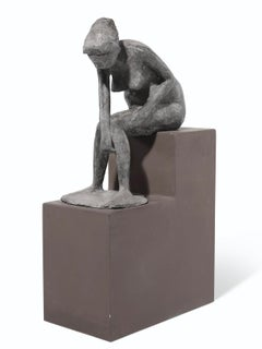 a bronze cast of a bathing girl signed with initials 'MM'