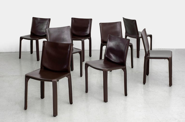 Classic leather Cab chairs by Mario Bellini for Cassina  Wonderful chocolate brown leather -  Excellent vintage condition. Priced individually.  Set of 8 available.