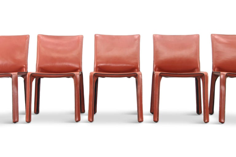 Cassina produced cab chairs by Mario Bellini. Set of six.   Elegant and minimalistic CAB chairs, the steel base is covered with beautiful thick oxblood red leather, giving these chairs tons of character.