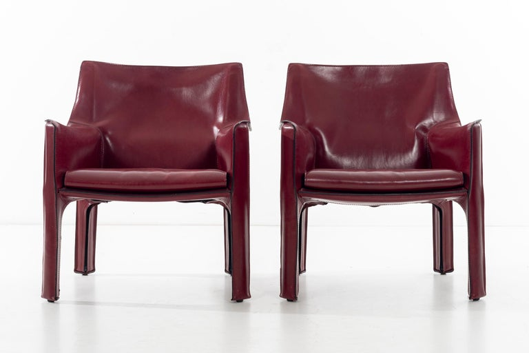 Bellini for Cassina, cab chairs in oxblood Italian leather, high-quality chairs consists of a leather cover stretched over a minimal tubular steel frame. The only additional reinforcement is provided by a rubber membrane plate that supports the
