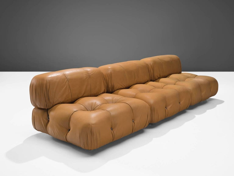 Mario Bellini, modular 'Camaleonda' sofa in original cognac leather upholstery, Italy, 1972.  The sectional elements of this can be used freely and apart from one another. The backs and armrests are provided with rings and carabiners, which allows