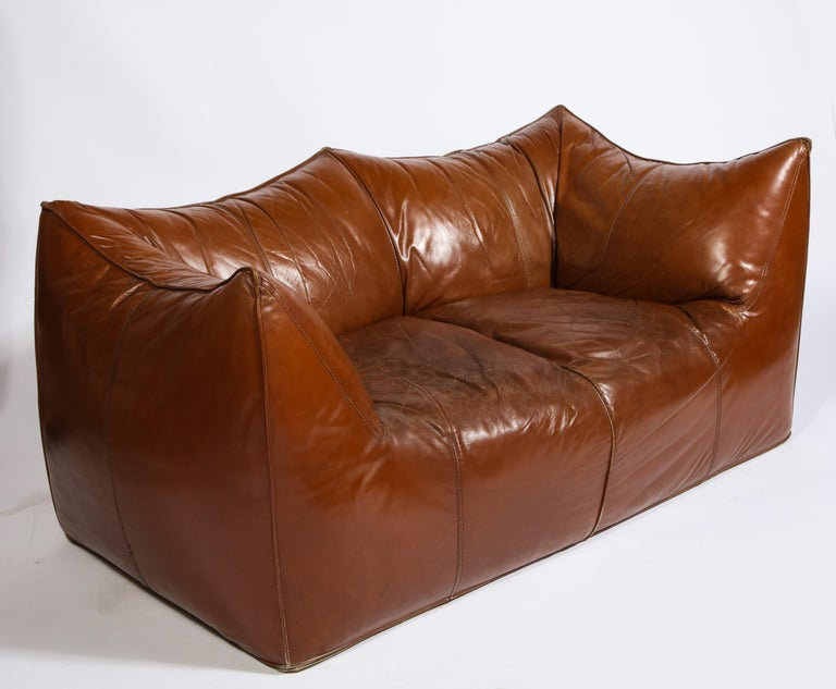 Mario Bellini Cognac brown leather sofa, chair, ottoman Bambole set, Italy.   Sofa set, beautiful deep cognac color. Beautiful vintage condition, Italy, 1970s.  Measures: Sofa 30 inches high 63 inches wide 31 inches deep 15 inches seat