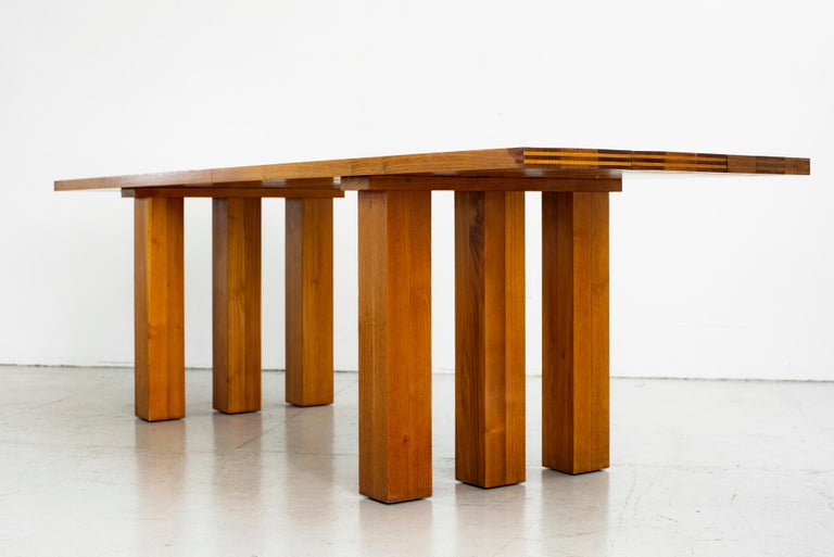 """Mario Bellini 451 Basilica dining table designed in 1975 for Cassina.  Architectural design in walnut with six column legs and large rectangular top.  Wonderful patina throughout with visible open grain on top.  Measures: W 98.5"""" x D 30.75"""" x H"""