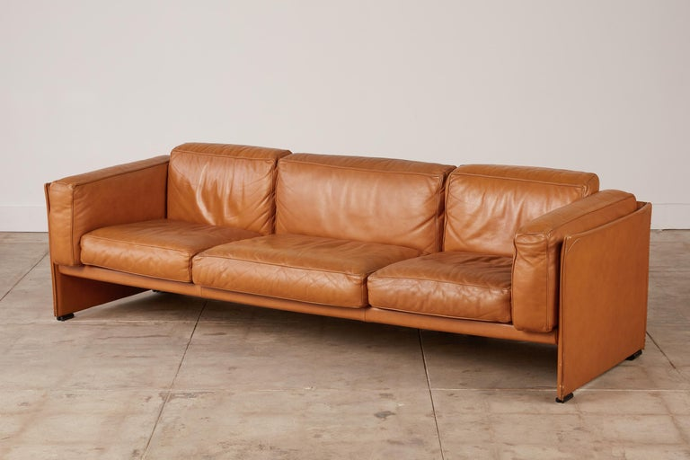405 Duc' three-seat sofa by Mario Bellini for Cassina, Italy, c.1970s. Leather-wrapped panels attached by zippers that is a classic Bellini design element to create the base structure for this piece with thick loose box cushions inside the frame
