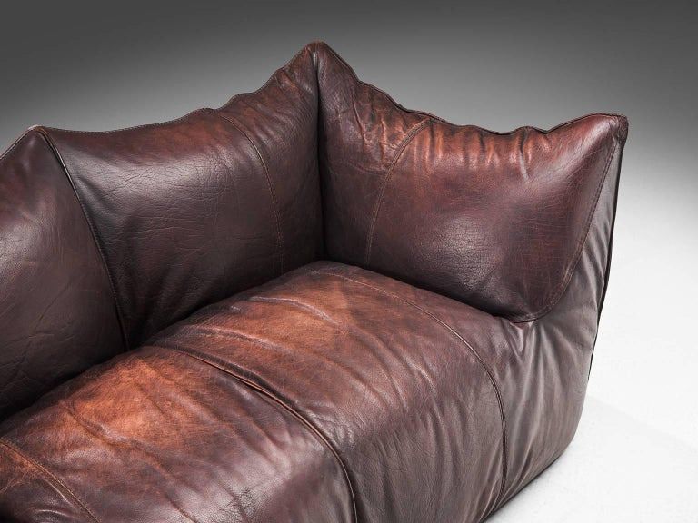 Mario Bellini for B&B Italia, 'Le Bambole' sofa, brown leather, Italy, 1972.  This comfortable dark brown settee is bulky and playful, shaped as if it is merely a large cushion and the accompanying feeling is the same. It is designed by Mario