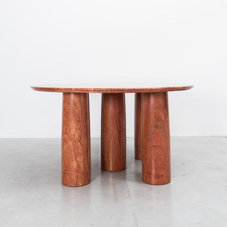A large round Il Colonnato table, designed by Milanese architect Mario Bellini. The table is a sought after piece, perhaps due to the monumental presence it commands within a space. Minimal in design, with five column legs, it is constructed