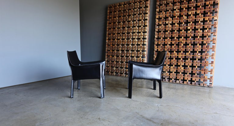 Mario Bellini 414 black leather cab lounge chairs for Cassina. This pair is in very good original condition.