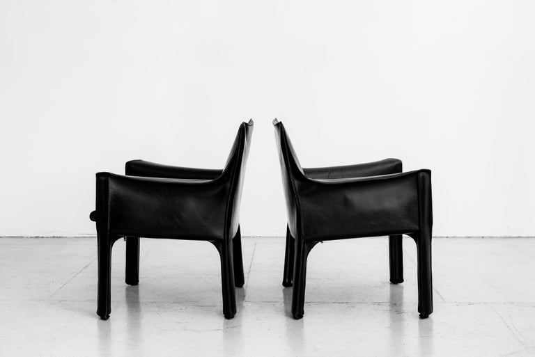 Pair of Mario Bellini for Cassina, cab lounge chairs in black Italian leather Extra wide with padded seat Wonderul patina to leather.